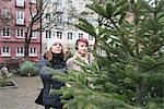 Women choosing Christmas tree