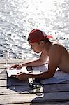 Man reading at water