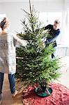 Girls decorating Christmas tree