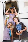Children using binoculars outside RV