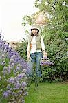 Woman gathering flowers in garden