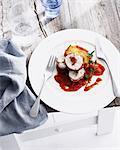 Plate of chicken involuntini with tomato