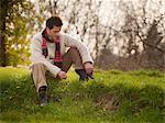 Man sitting in grassy field