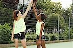 Women cheering on basketball court