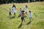 Children in costumes running in field