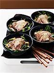 Bowls of pork fillets with noodle salad