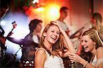 Teenage girls dancing at concert