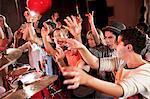 Teenagers dancing at concert