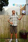Man holding football in garden