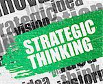 Business Education Concept: Strategic Thinking. Green Inscription on the Brick Wall. Strategic Thinking Modern Style Illustration on Green Distressed Paintbrush Stripe.