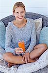 Healthy woman sitting with orange juice