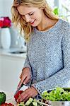 Healthy woman preparing vegetable salad