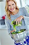 Healthy woman preparing lettuce salad