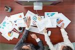 Top view of Japanese businesspeople talking in meeting room
