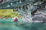 Man kayaking around marble caves, Puerto Tranquilo, Aysen Region, Chile, South America