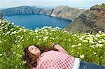 Girl asleep on bed of flowers, O'a, Santorini, Kikladhes, Greece