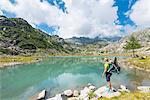 Tourist to the lower Cornisello lake Europe, Italy, Trentino region, Nambrone valley, Rendena valley, Carisolo, Sant'Antonio di Mavignola, Madonna di Campiglio