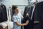 Woman examining blazer