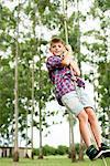 Boy swinging on rope outdoors