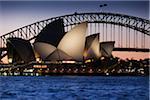 Sydney Opera House and the Sydney Harbour Bridge at dusk in Sydney, Australia