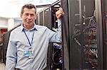 Portrait confident male IT technician in server room