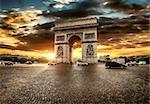 Beautiful cloudy sunset over Arc de Triomphe in Paris, France