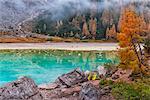 Italy, Veneto, Cortina d'Ampezzo, Hiking tent in Sorapiss lake.