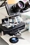 Close-up of microscope in laboratory