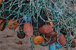 Close-up of tangled fishing net and buoys at beach, Tayrona, Columbia