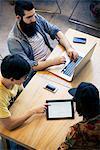 Friends using digital tablet together