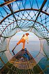 Inle lake, Nyaungshwe township, Taunggyi district, Myanmar (Burma). Local fisherman through the typical conic fishing net.