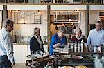 Senior male and female friends enjoying lunch buffet in restaurant