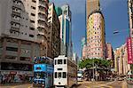 Trams passing through the shopping district, Wan Chai, Hong Kong, China, Asia