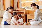Teachers with kids at Japanese kindergarten