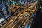 High angle cityscape with city highway at night, Dubai, United Arab Emirates
