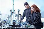 Robotics apprentices with production line simulation in robotics facility