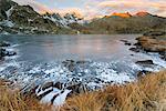 Italy, Trentino Alto Adige, Adamello Brenta Park, Nambrone valley, Dawn at Black Lake, in background Presanella group sunlit.