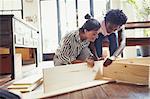 Young women assembling furniture