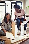Women assembling furniture