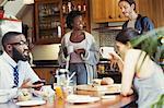 Friend roommates enjoying breakfast in kitchen