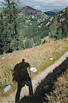 Shadow of hiker on the Pacific Crest Trail, near Harts Pass, Pasayaten Wilderness, Washington.