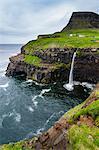 Gasadalur waterfall into the ocean, Vagar, Faroe Islands, Denmark, Europe