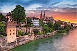 Cityscape image of Basel, Switzerland during dramatic sunset.