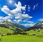 Summer mountain  sunshiny view to Biberkopf mount (Warth, Vorarlberg, Austria) and deep blue sky with clouds.