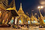 Devotees come to pray at Shwedagon Pagoda, Yangon (Rangoon), Myanmar (Burma), Asia