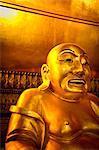 A Smiling Buddha inside Wat Pho (Wat Po), Bangkok, Thailand, Southeast Asia, Asia