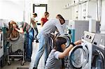 University students using washing machines at campus laundromat