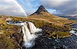 View of Kirkjufell (Church Mountain), mountain stream and rainbow, Grundafjordur, Snaefellsnes Peninsula, Iceland, Polar Regions