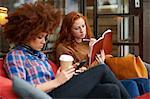 Friends relaxing in coffee shop