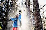 Skier celebrating in snow